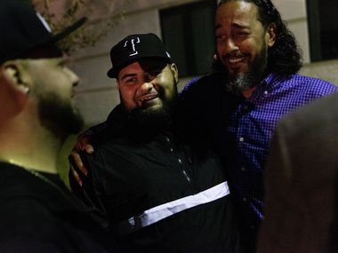 Brandon Ray Gonzales (center), 23, receives a hug from his cousin, the Rev. Philip Williams (right), following Gonzales' release from jail outside the Hunt County Sheriff's Office in Greenville on Tuesday.