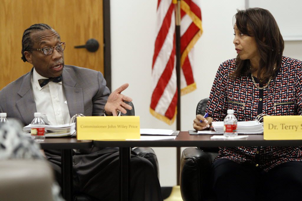 Dallas County Commissioner John Wiley Price spoke with Dallas County Juvenile Board member Terry Smith during a meeting  in July 2014.