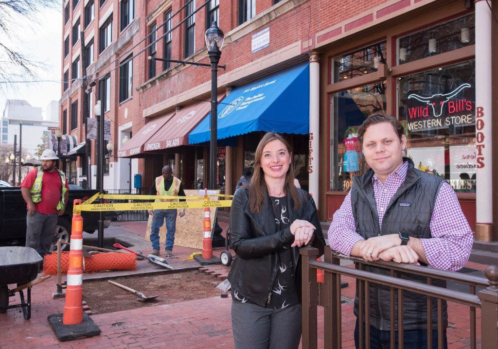Jennifer Sanders, left, and Trey Bowles, co-founders of the Dallas Innovation Alliance, stand near where the first smart city kiosk is being installed in the West End.