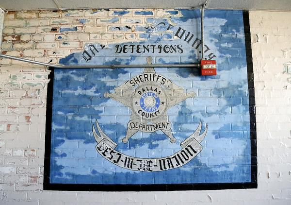 A peeling mural painted by inmates adorns the the wall of a break room in the jail section of the old Dallas County Criminal Courts Building downtown.