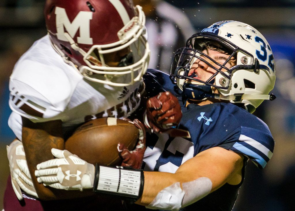 L.D. Bell middle linebacker Ethan Schackman (32) brings down Mesquite wide receiver Keldrick Demus (10) during the first half of a high school football game on Thursday, Sept. 19, 2019, in Bedford, Texas. (Smiley N. Pool/The Dallas Morning News)