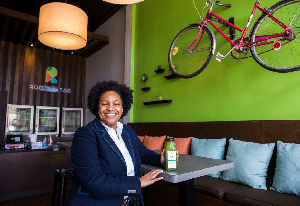 Owner Nicole Allen poses for a portrait inside Roots on Tap across the street from Fair Park on Friday, January 20, 2017 on Parry Avenue in Dallas.