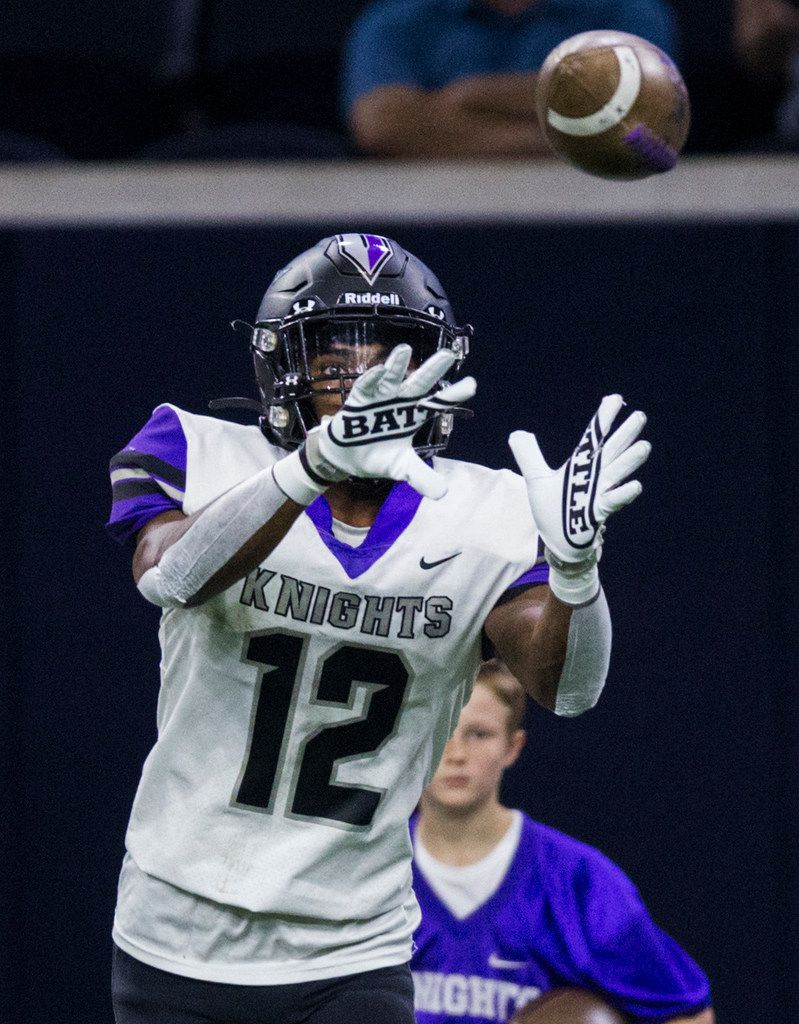 Frisco Independence receiver Zhighlil McMillan (12) catches a pass during the first quarter of a District 5-5A Division I high school football game between Frisco Independence and Frisco Lone Star on Thursday, October 10, 2019 at the Ford Center at The Star in Frisco. (Ashley Landis/The Dallas Morning News)