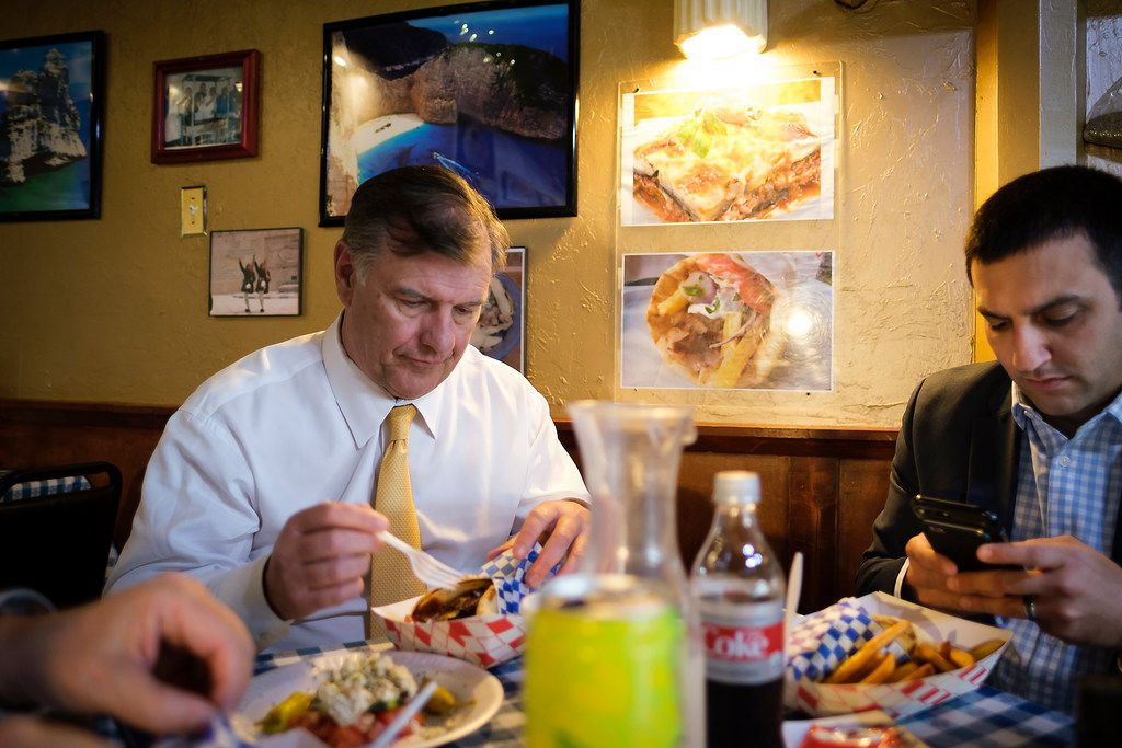 Dallas Mayor Mike Rawlings  eats dinner with his Chief of Policy and Communications Scott Goldstein during a break in an offsite city council meeting at the Kleberg-Rylie Recreation Center  on Wednesday, May 8, 2019. (Smiley N. Pool/The Dallas Morning News)