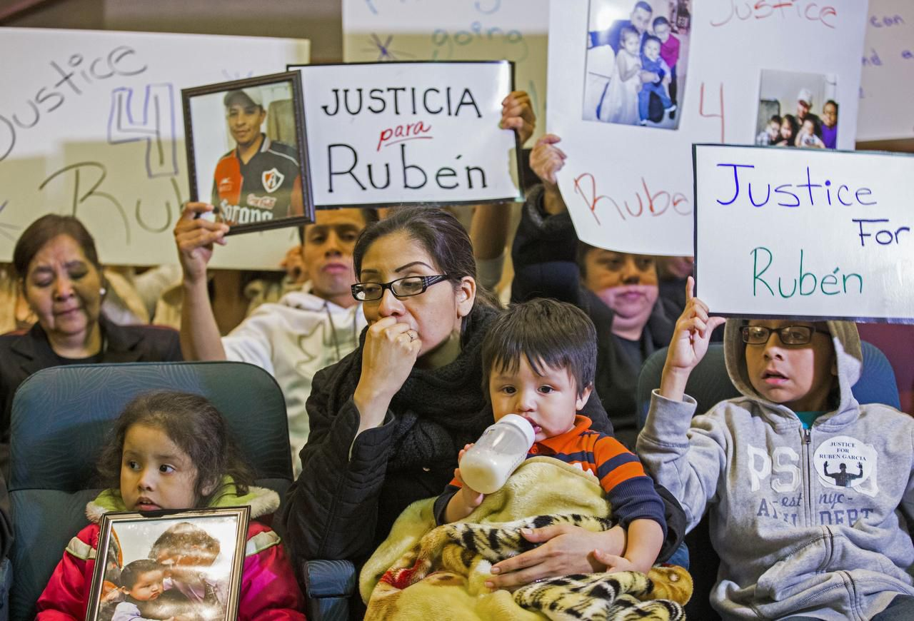 Martha Anjelica Romero, holding Abdiel, 1, and flanked by her children Keila García (left), 4, and Edwin Romero, 10, sits on the front row. Her unarmed husband, Rubén García Villalpando, 31, was shot to death by a Grapevine officer.