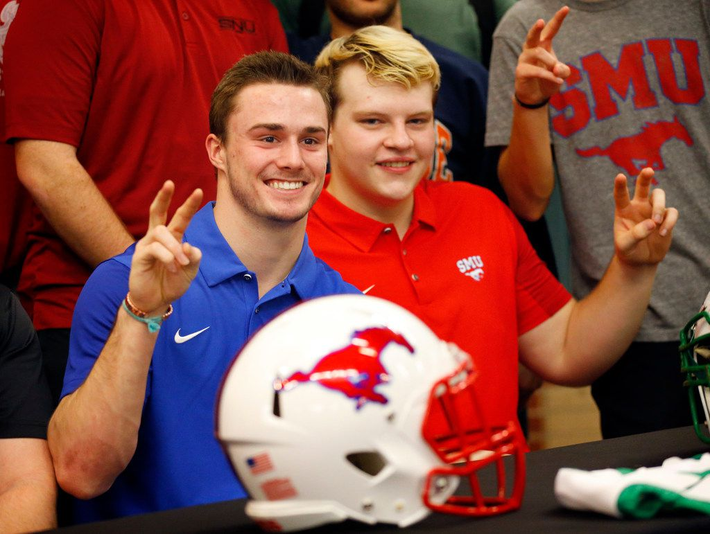 Southlake Carroll running back T.J. McDaniel (left) and offensive lineman Henry Mossberg pose for photos after signing letters of intent to play at SMU during a National Signing Day ceremony in Southlake, Texas, Wednesday, February 6, 2019. (Tom Fox/The Dallas Morning News)