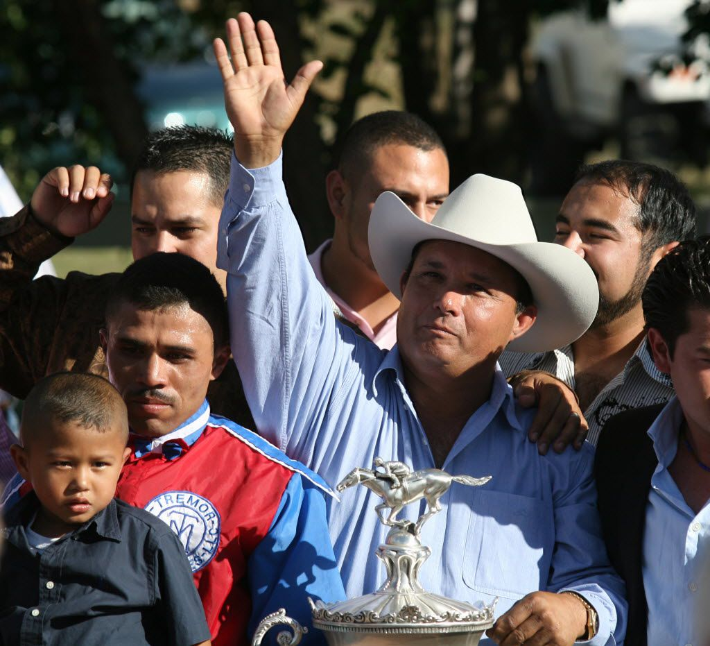 Jose Trevino stood in the winner's circle at Ruidoso Downs, N.M., after his horse Mr. Piloto won the All American Futurity race.