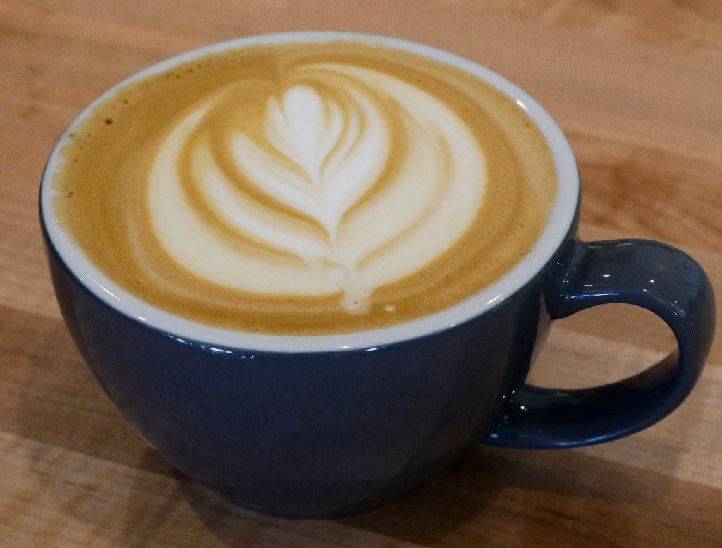 A finished plain latte photographed at the new George Coffee + Provisions in Coppell, Texas Thursday July 20, 2017.  (Ron Baselice/ The Dallas Morning News)