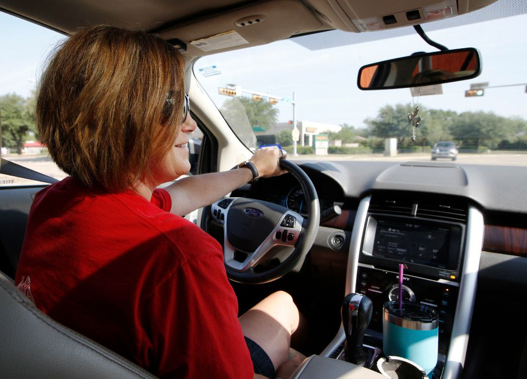 Andrea Gillette, 35, drives from Garland to her job at Fish City Grill in Richardson.  She works as a part-time manager and bartender and some days works a double shift.