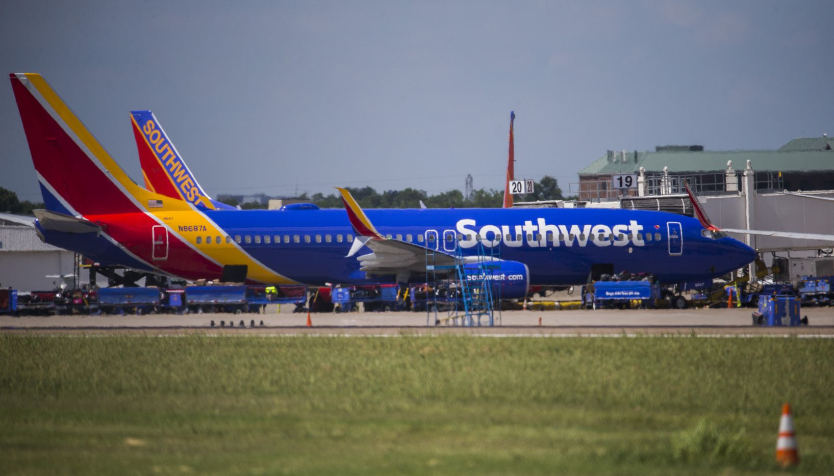 Southwest Airlines airplanes are parked at terminals while computer systems recover on Wednesday, July 20, 2016 at Dallas Love Field Airport in Dallas. (Ashley Landis/The Dallas Morning News)