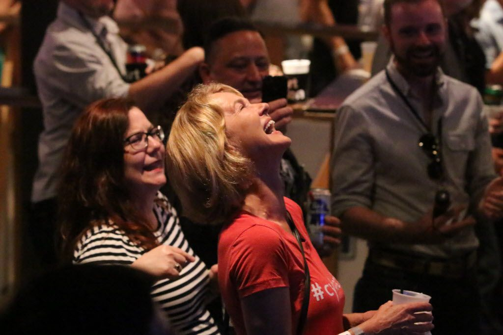 A bidder during the live auction had a laugh after the bidding war ended at Art Con Skewed at Life in Deep Ellum on June 6, 2015