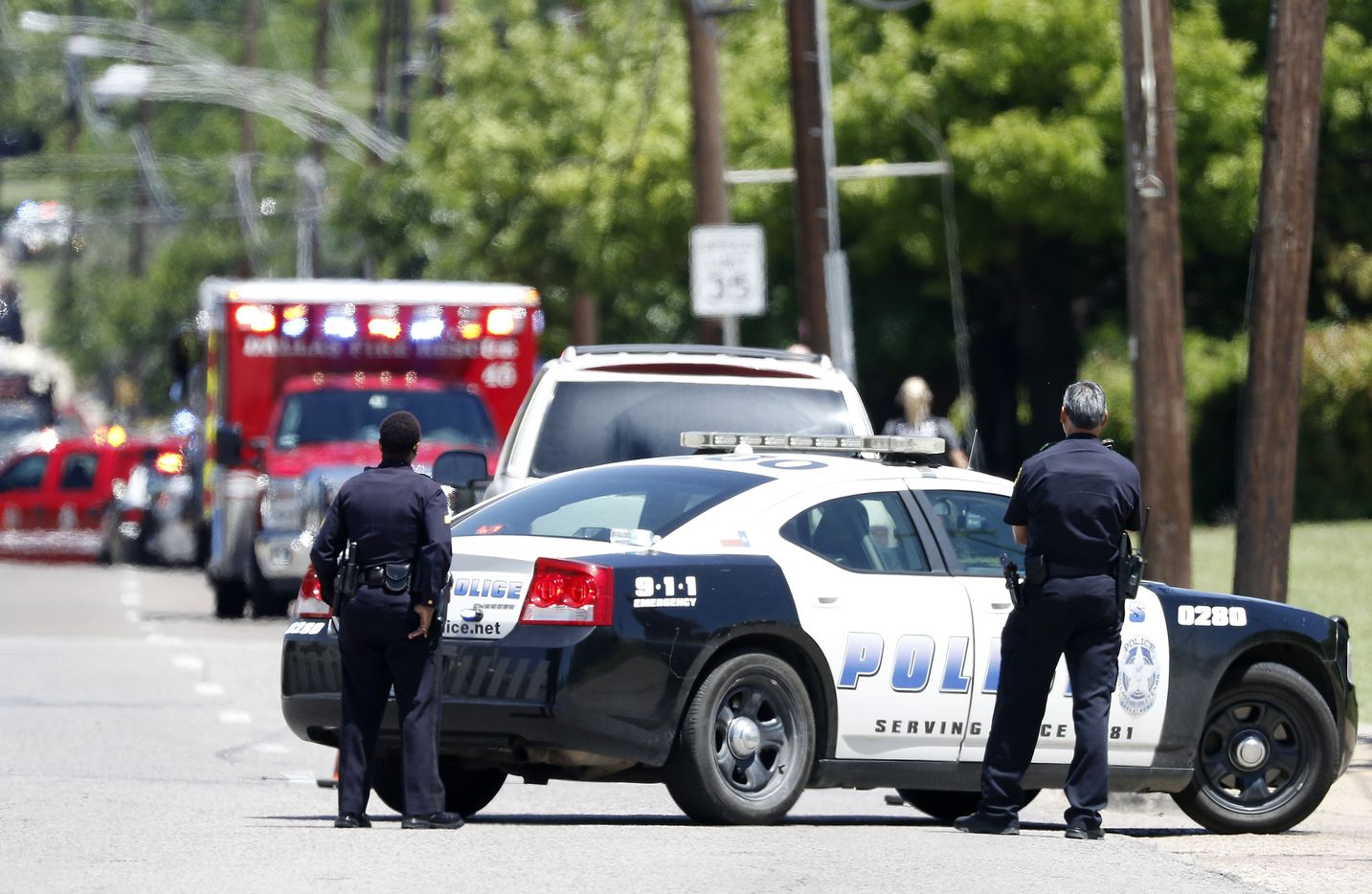 Dallas Police Officers work on the active shooting scene on Dolphin Road in Dallas, Monday, May 1, 2017. (Jae S. Lee/The Dallas Morning News)
