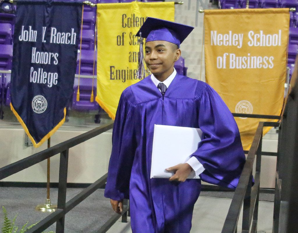 14-year-old Carson Huey-You walks off the stage after receiving a bachelor's degree in physics at TCU (Louis DeLuca/Dallas Morning News)