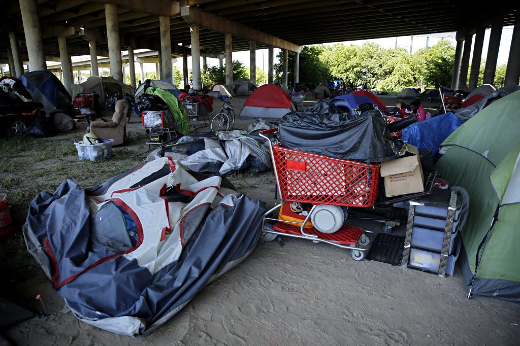 Tents are pitched and belongings put into place as residents from Tent City find a new place to camp nearby Tuesday, May 3, 2016 in Dallas. The final two sections of the contentious homeless encampment where closed Tuesday morning, sending the remaining residents scrambling for shelter.