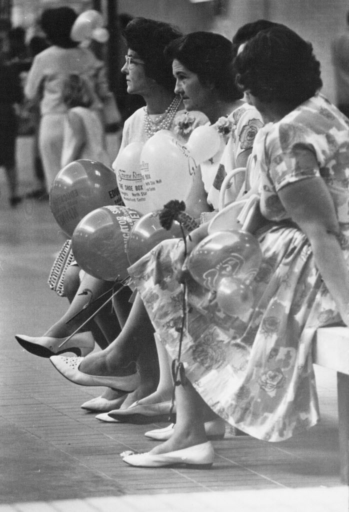 Women dressed up to come to NorthPark's opening on Aug. 19, 1965. They're holding balloons from Kinney Shoes and Stride Ride. Notice the white flats. They're in style again.