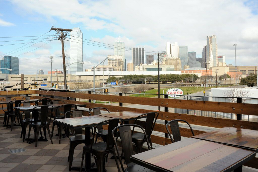 The large patio extended from Vetted Well features views of downtown Dallas..