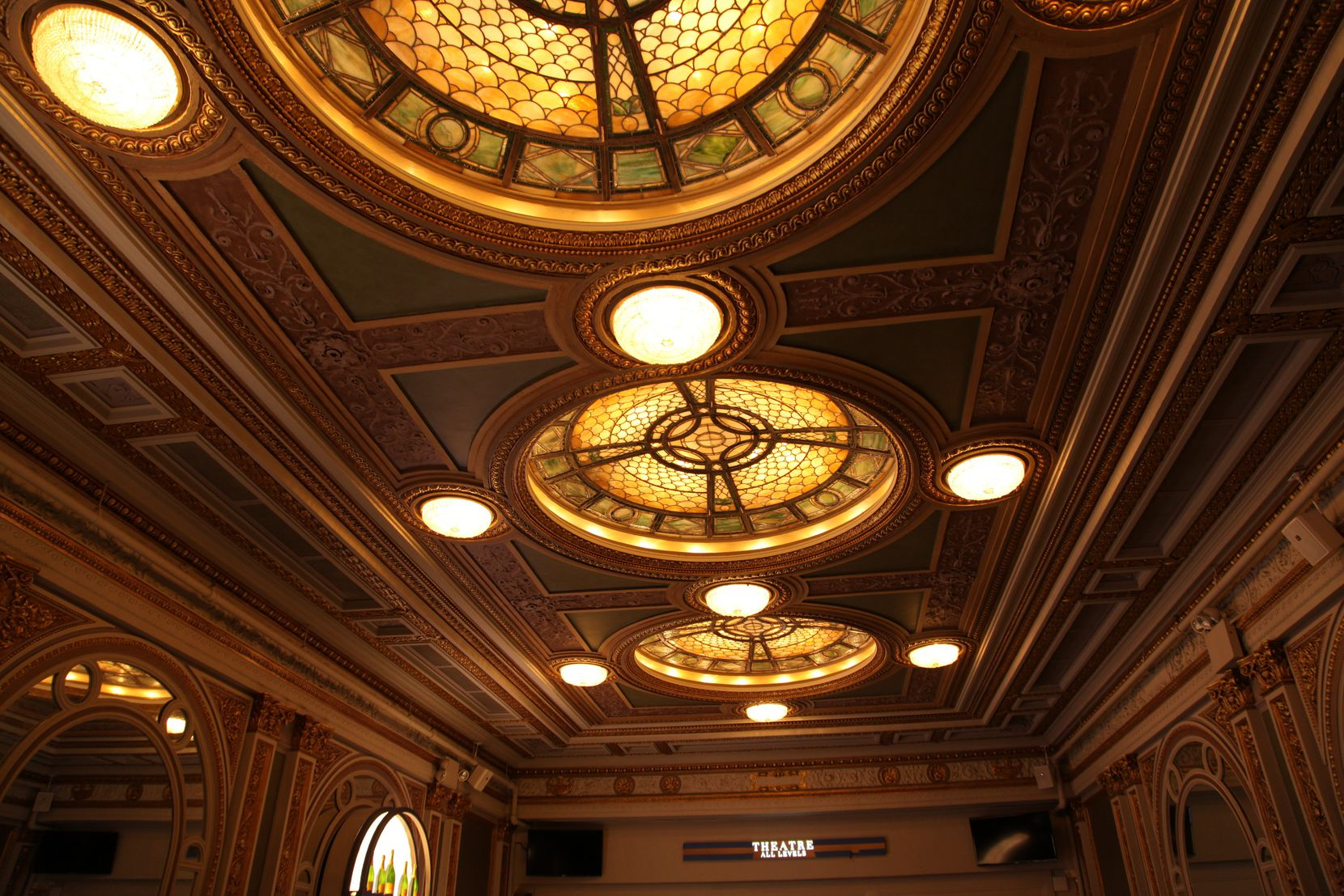 The triple-domed stained glass and bronze ceiling in the lobby is among the classic architectural touches at the Hudson Theatre.
