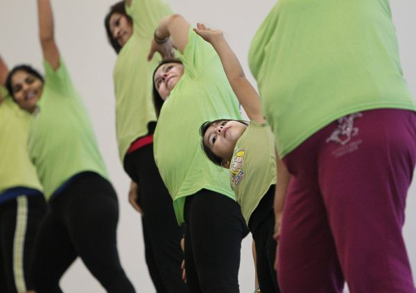 Melissa Salazar, 7, and others attend an exercise class at the Jubilee Park community center. The center was opened last September as part of the revitalization plan for the South Dallas neighborhood.