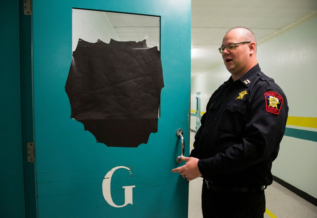 Capt. Matthew Kimbler, the jail administrator, shows black paper covering a window for privacy outside a women's unit. With more women in the jail, sometimes his job now includes policing inappropriate love letters between inmates.