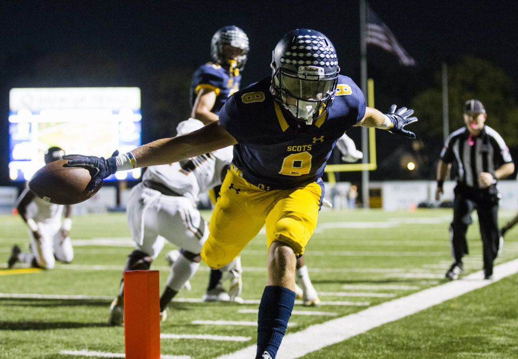 Highland Park running back Conner Allen (8) holds the ball over the goal line for a touchdown as he runs out of bounds during the first quarter of a high school football game between West Mesquite and Highland Park on Friday, October 13, 2017 at Highland Park's Highlander Stadium in Dallas. (Ashley Landis/The Dallas Morning News)