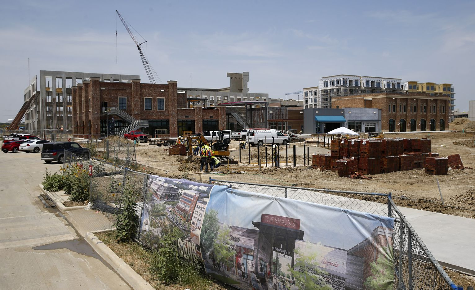 Construction of the new retail village on the shore of North Lake in the Cypress Waters development.