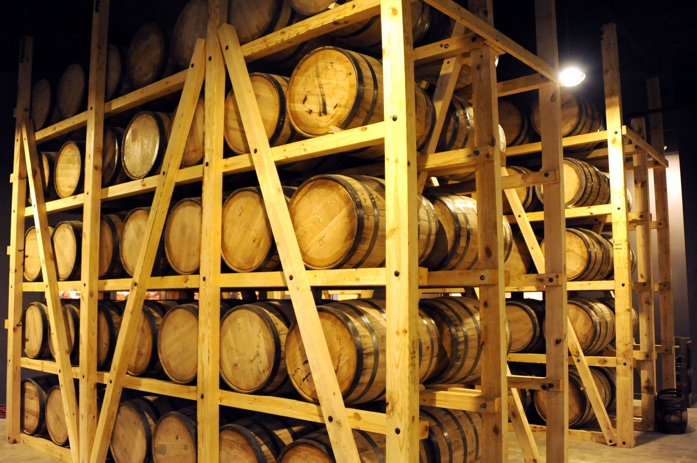 Barrels of whiskey bourbon and rum line the walls at Witherspoon Distillery in Lewisville, TX on October 24, 2015.