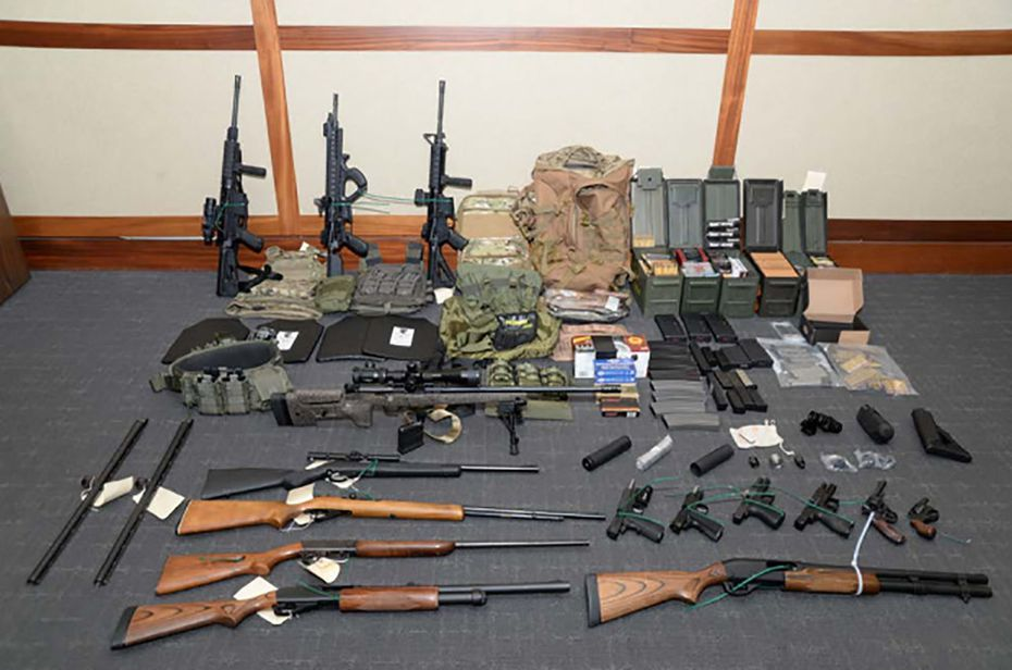This image released by the US Attorney's Office shows weapons seized at the Silver Spring, Md., home of US Coast Guard officer Christopher Paul Hasson. Hasson, who espoused white supremacist views and drafted a target list of Democratic politicians and prominent media figures, was arrested on firearms and drug charges.