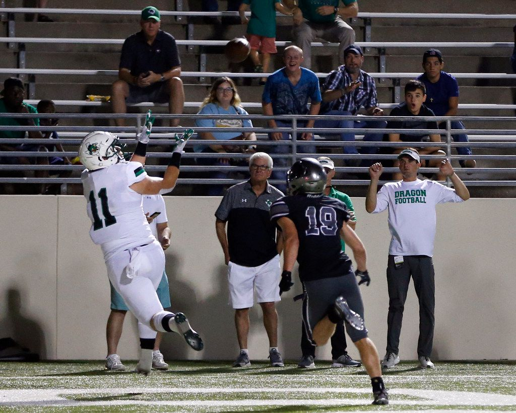 Southlake Carroll's Blake Smith (11) prepares to catch a touchdown in front of Denton Guyer's Seth Meador (19) at the end of the first half of play at C.H. Collins Complex in Denton, on Friday, October 4, 2019. (Vernon Bryant/The Dallas Morning News)