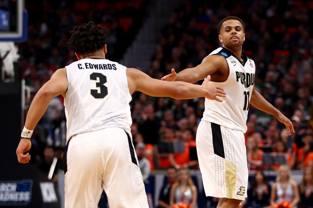 DETROIT, MI - MARCH 16:  Carsen Edwards #3 and P.J. Thompson #11 of the Purdue Boilermakers celebrate against the Cal State Fullerton Titans during the second half of the game in the first round of the 2018 NCAA Men's Basketball Tournament at Little Caesars Arena on March 16, 2018 in Detroit, Michigan.  (Photo by Gregory Shamus/Getty Images)