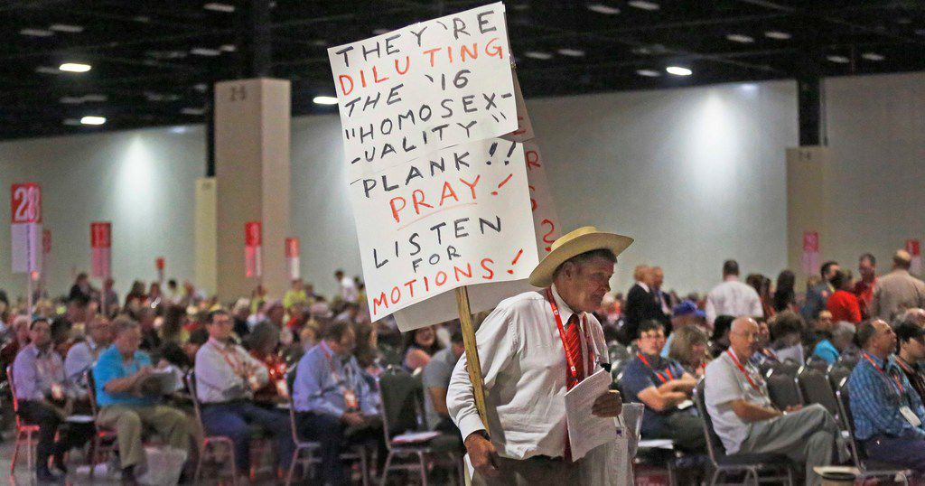 Delegates watch as a sign is carried up and down the aisles in the session seating area detailing possible changes in the party plank addressing homosexuality during the 2018 Texas GOP Convention held at the Henry B. Gonzâlez Convention Center in downtown San Antonio.