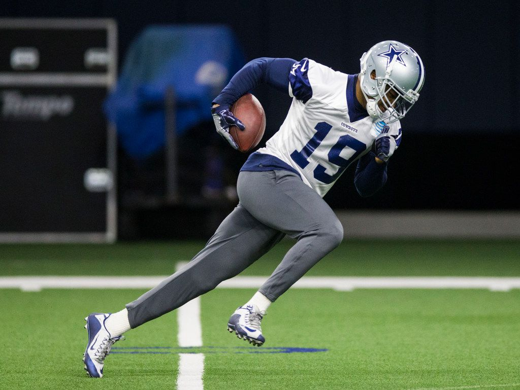 Dallas Cowboys wide receiver Amari Cooper (19) runs the ball during a Dallas Cowboys OTA practice on Wednesday, May 29, 2019 at The Star in Frisco. (Ashley Landis/The Dallas Morning News)