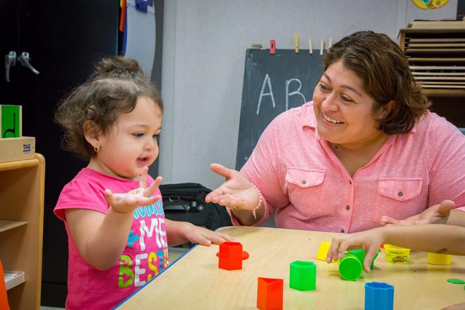 A mother learns ways to teach her child during a classroom session at Bachman Lake Together Family Center.