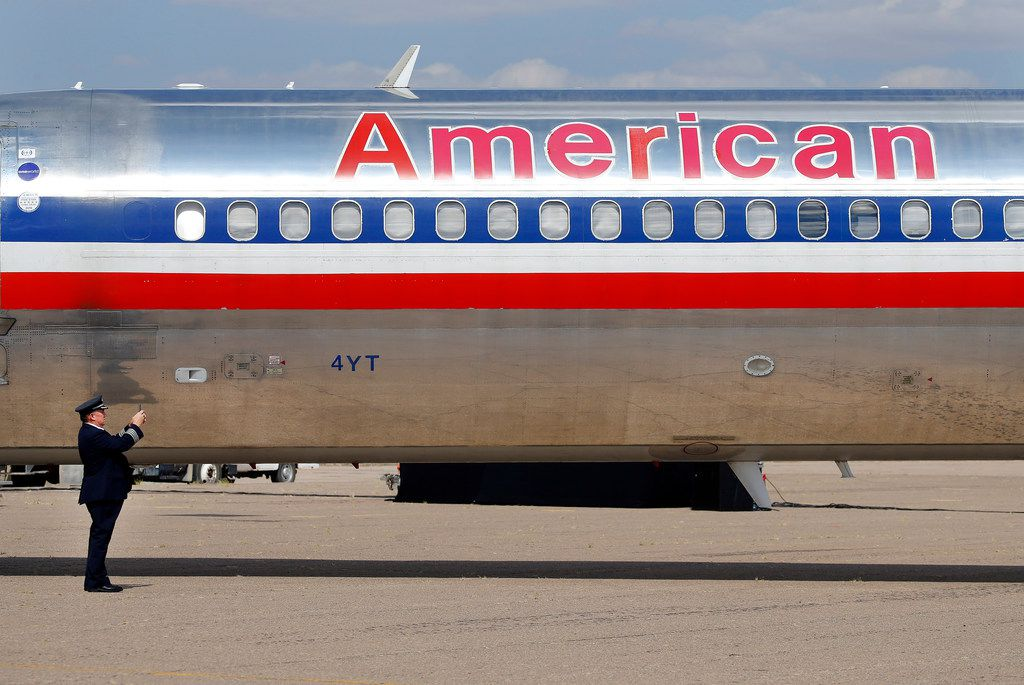 American Airlines Captain Steve Stricklin takes a photo of the MD-80 he ferried from Dallas-Fort Worth to Roswell International Air Center.