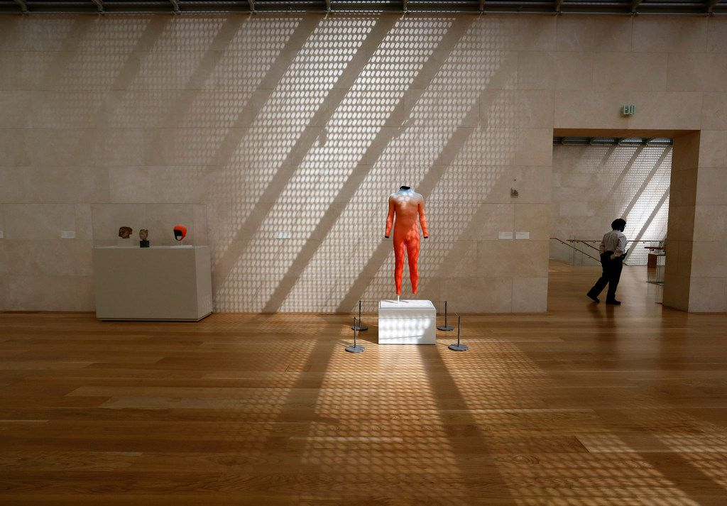 Glare from by the highly reflective glass in the 42-story high-rise Museum Tower is shown permeating the galleries at the Nasher Sculpture Center, affecting the presentation of works by sculptor Alex Israel in August.