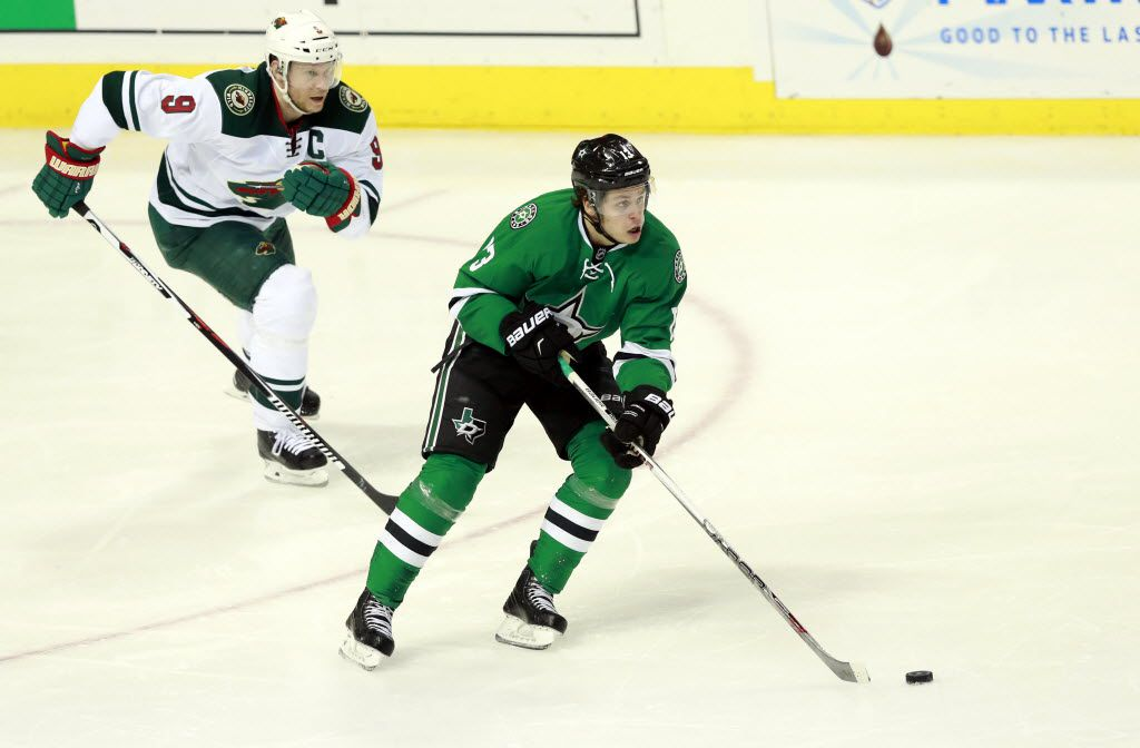 Dallas Stars center Mattias Janmark (13) skates up the ice ahead of Minnesota Wild center Mikko Koivu (9) in the second period during Game 5 of the Western Conference Quarterfinals at the American Airlines Center in Dallas, Friday, April 22, 2016. (Tom Fox/The Dallas Morning News)