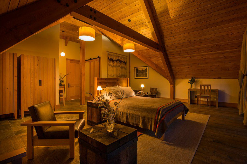 An upstairs bedroom offers a relaxing environment for guests at the Minam River Lodge.