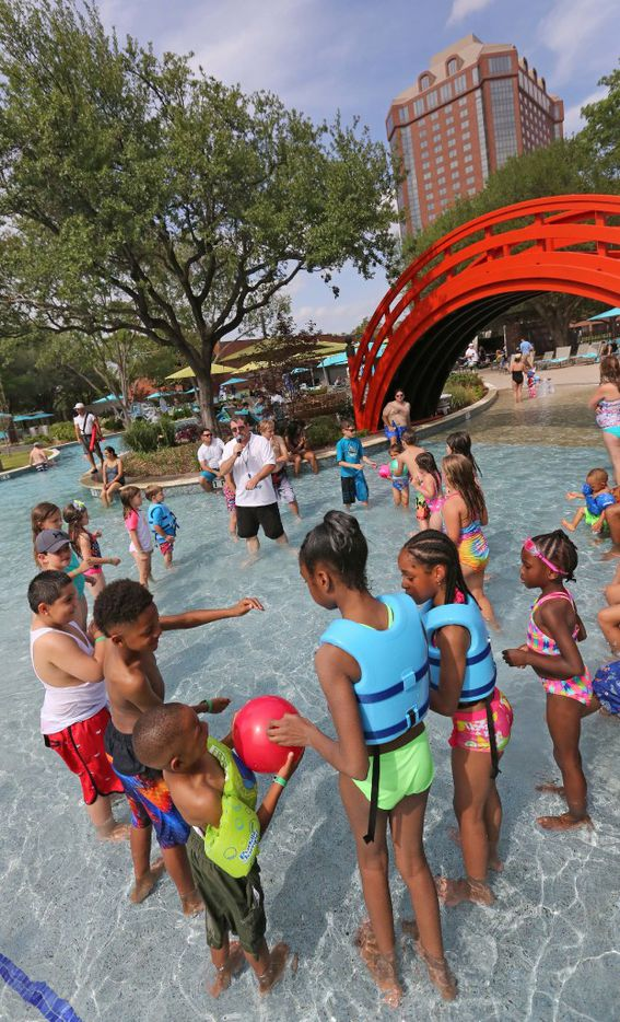 A party for young swimmers is held at JadeWaters, the water park and lazy river at the Hilton Anatole Hotel in Dallas, photographed on Friday, May 26, 2017. (Louis DeLuca/The Dallas Morning News)