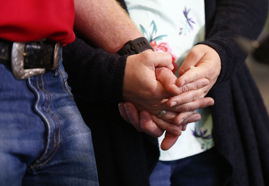 Andrew Needum and his wife Stephanie Needum held hands as they talked about their experience on Southwest Airlines Flight 1380. (Nathan Hunsinger/The Dallas Morning News)