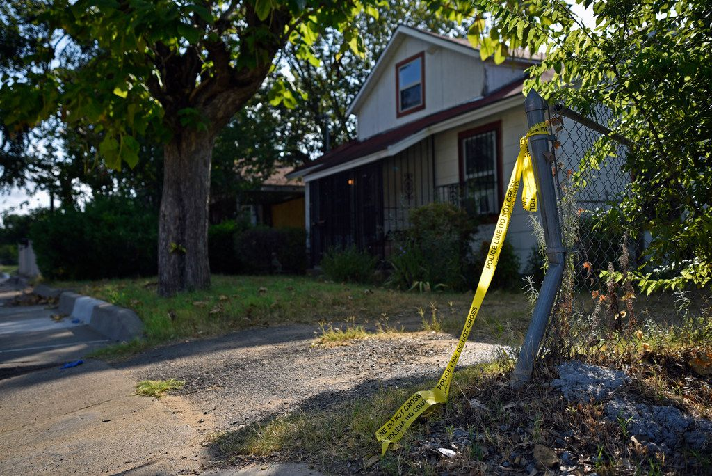Crime scene tape remains outside of a house on the 4200 block of Jamaica Street in Dallas, Sunday morning Aug. 18, 2019.