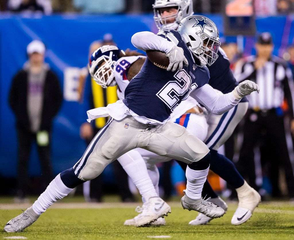Cowboys running back Ezekiel Elliott (21) runs the ball during the fourth quarter of a game against the New York Giants on Monday, Nov. 4, 2019, at MetLife Stadium in East Rutherford, N.J. (Ashley Landis/The Dallas Morning News)