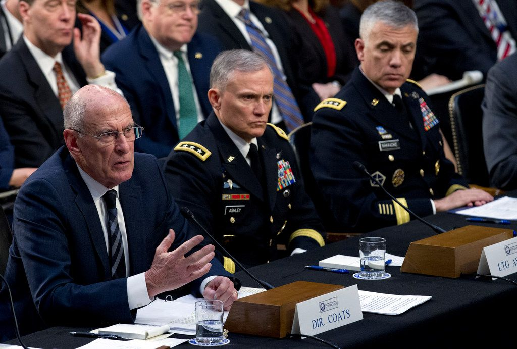 Director of National Intelligence Daniel Coats (left), accompanied by Defense Intelligence Agency Director Gen. Robert Ashley and National Security Agency Director Gen. Paul Nakasone, testifies before the Senate Intelligence Committee on Capitol Hill in Washington Jan. 29, 2019. (AP Photo/Jose Luis Magana)