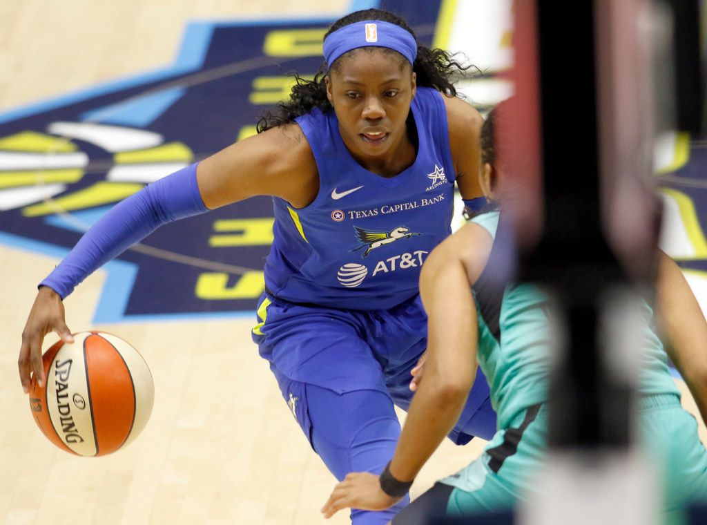 Dallas Wings guard Arike Ogunbowale (24) drives to the basket against a New York Liberty defender during first half action. The two WNBA teams competed in their game which was held at College Park Center in Arlington on August 16, 2019. (Steve Hamm/ Special Contributor)