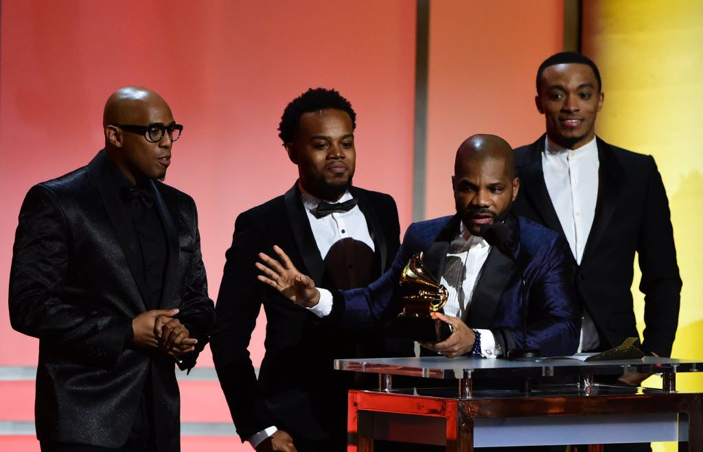 Gospel singer  Kirk Franklin accepts the award for the Best Gospel Performance/Song with other young gospel singers onstage during the 58th Annual Grammy Premiere ceremony in Los Angeles February 15, 2016. (AFP PHOTO/  ROBYN BECKROBYN BECK/AFP/Getty Images)