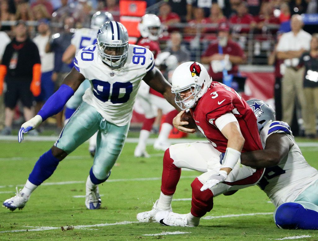 Cowboys defensive tackle Maliek Collins (96) sacks Arizona Cardinals quarterback Carson Palmer (3) with DeMarcus Lawrence (90) nearby during a game between the Cowboys and Cardinals at University of Phoenix Stadium in Glendale, Ariz., on Monday, Sept. 25, 2017. (Andy Jacobsohn/The Dallas Morning News)
