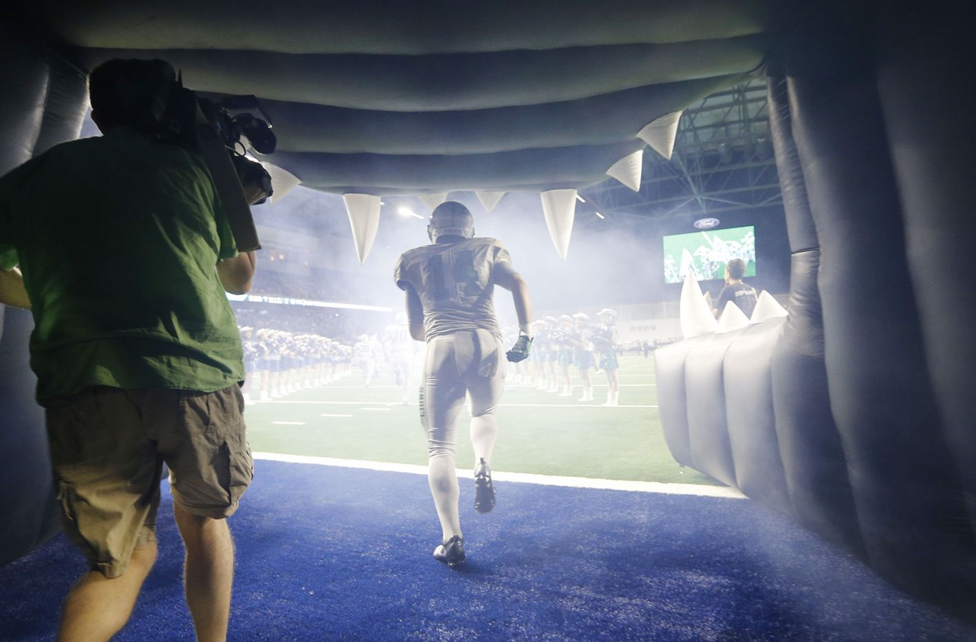 Reedy's Ridge Gibbs (14) makes his way onto the field before playing against Independence High School during the first high school football game at The Star in Frisco on Saturday, August 27, 2016. (Vernon Bryant/The Dallas Morning News)