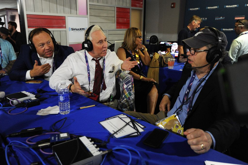 Alex Jones, of Infowars, and Roger Stone, former Donald Trump advisor, debate with Jonathan Alter during an episode of Alter Family Politics on SiriusXM at Quicken Loans Arena on July 20, 2016 in Cleveland, Ohio.
