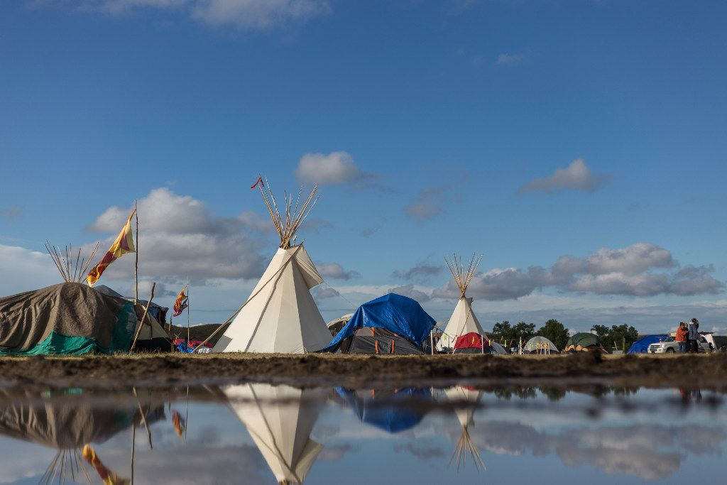 Reflection of inside of Oceti Sakowin camp after the rain in Cannonball, North Dakota on Thursday, Sep15th, 2016. Standing Rock has seen hundreds of whole families and activists visit, eager to take part in the historic gathering.  Construction has been halted after the Obama administration decision to suspend construction on a controversial oil pipeline in North Dakota.  (Jeenah Moon/Special Contributor