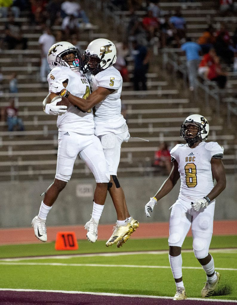 South Oak Cliff senior wide receiver DeMarco Moon (4) celebrates his late game go-ahead touchdown reception with senior wide receiver Donajz Dunn (5) as junior wide receiver Lafeyette Pate (8) looks on during the fourth quarter a high school football game against Skyline on Friday, August 30, 2019 at John Kincaide Stadium in Dallas. South Oak Cliff won 22-21. (Jeffrey McWhorter/Special Contributor)