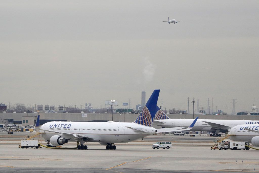 In this Wednesday, Jan. 23, 2019 file photo, United Airlines jets are seen as a plane approaches Newark Liberty International Airport, in Newark, N.J. United Airlines will woo high-fare passengers by retrofitting more than 100 planes to add more premium seats on key routes.