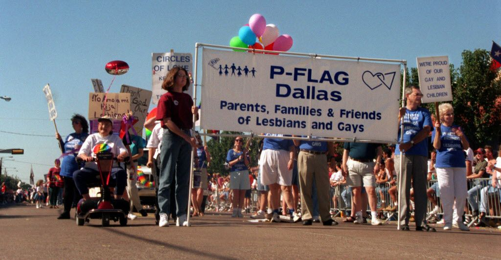 Members and supporters of Parents, Families & Friends of Lesbians and Gays (PFLAG) show their  support during the Gay Pride Parade on Sept. 29, 1996. The parade ran down  Cedar Springs Road and ended with activities in Lee Park.
